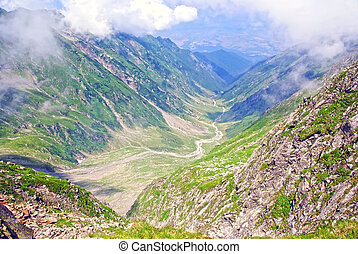 Alpine valley with few clouds, Fagaras mountains.
