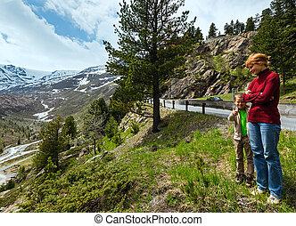 Summer mountain view from Kaunertaler Gletscherstrasse and mother with son(Kaunertal, Austria, Tirol).