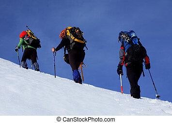 Alpinists climbing in Piatra Craiului Mountains, Romania.