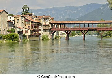 Alpini bridge is the covered wooden pontoon bridge designed by the architect Andrea Palladio in 1569. The bridge is located in Bassano del Grappa, Italy and was destroyed many times, the last time in World War II. The bridge spans the river Brenta.