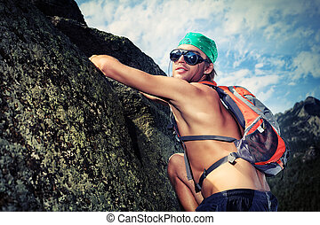 alpinism - Young man alpinist is climbing on a mountain.