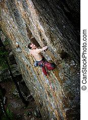 alpiniste mâle, rocher