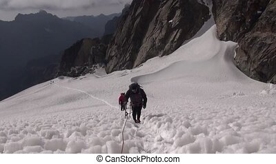 Alpinists to conquer the top - Mountaineer climbs a steep...