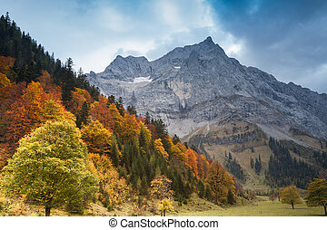 Alps autumn mountain landscape with dark blue sky. Austria, Tirol.
