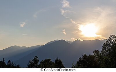 Alps mountain silhouette with sunset sky. Austria landscape