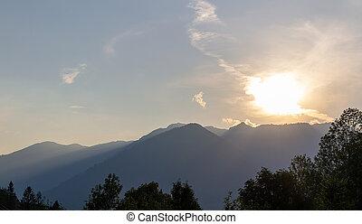 Alps mountain silhouette with sunset sky. Austria landscape