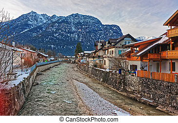 Alps Partnach River and wooden Chalets at Garmisch Partenkirchen