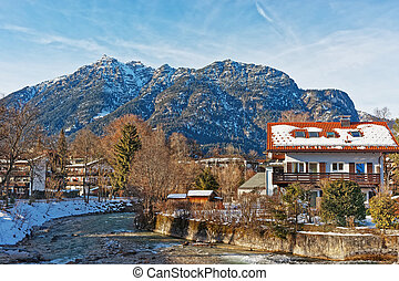 Alps Partnach River and wooden Chalets in Garmisch Partenkirchen