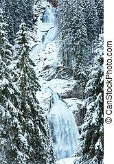 Alps waterfall winter view