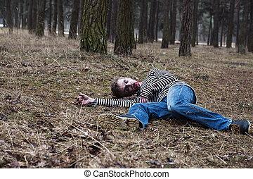 A bleeding zombie lying on the ground