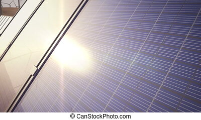 1080p stock video of a camera pan of solar panels and wind turbines in the desert.