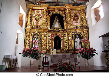Altar inside white church in Kali, Colombia