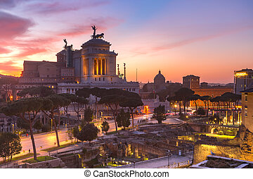 Ancient ruins of Trajan Forum and Altar of the Fatherland at sunsrise in Rome, Italy.