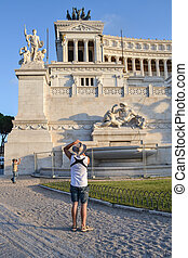 a photographer photos Altare della Patria, Rome , Italy