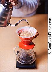 Alternative coffee making. Close-up image of barista making...