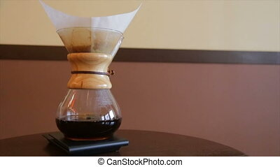 Alternative coffee-making methods. Brewed coffee in a glass...