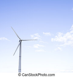 Alternative Energy Concepts. Windmill Outdoors Against Blue Sky.