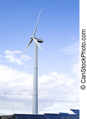 Alternative Energy Concepts. Windmill Outdoors Against Blue Sky. Vertical image