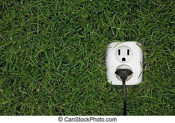 alternative energy - energy concept outllet in grass