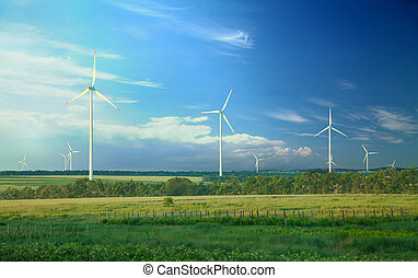 Alternative energy, wind turbines on green meadow