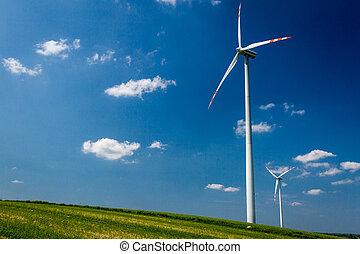 Alternative energy wind turbines on green field