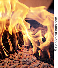 Wood pellets - Alternative fuel: Wood pellets burning in a...