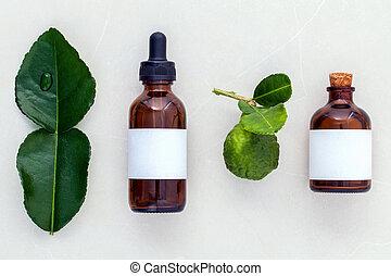 Alternative health care fresh kaffir lime leaves and oils on...