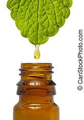 fluid drop is falling from leaf as symbol for alternative medicine