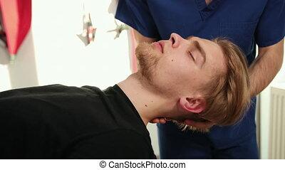 Alternative medicine, pain relief concept. Chiropractic, osteopathy, dorsal manipulation. Therapist doing healing treatment on man's neck . Alternative medicine, bearded man doctor