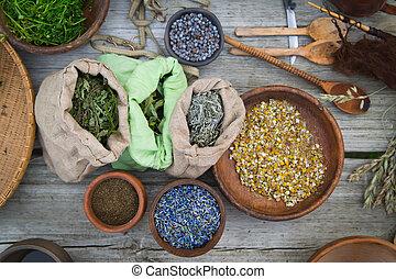 Alternative medicine - table full of herbs