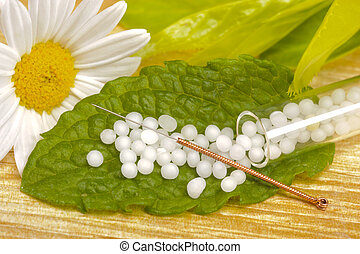 alternative medicine with acupuncture and homeopathy with...