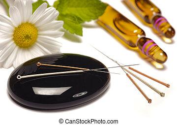 alternative medicine with acupuncture needles