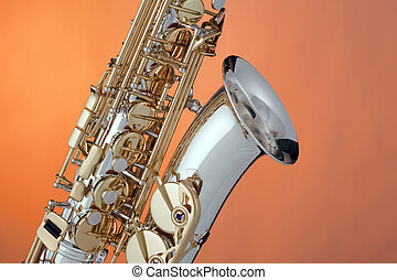 Alto Saxophone Isolated On Orange - A silver and gold ...