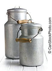 aluminium milk can on wooden table