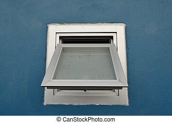 Aluminium window on blue wall
