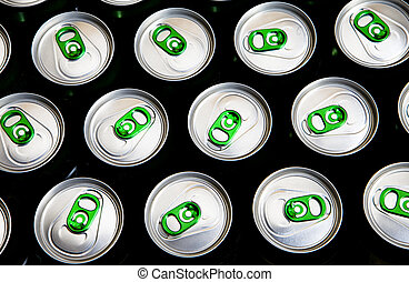 Aluminum cans in drops of water with keys close-up, focus on center