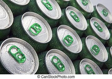 Aluminum cans in drops of water with keys close-up