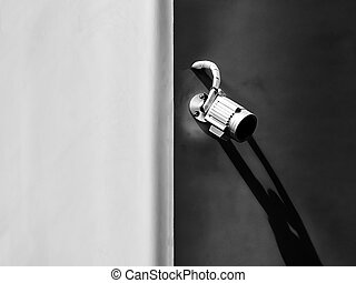 aluminum closed circuit camera for security on the concrete wall, black and white tone