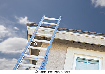 Construction Ladder Leaning Against House