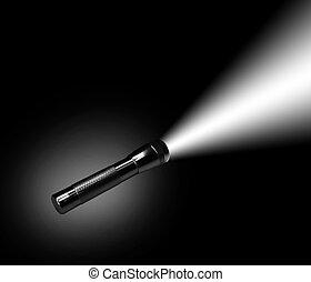Aluminum flashlight in night on black background