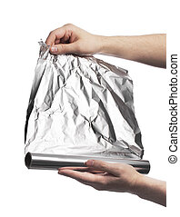 Aluminum foil - Man holding a roll of household aluminum...