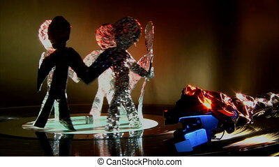 Aluminum people dance