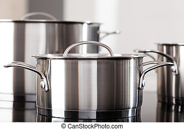 Aluminum pots on the kitchen top