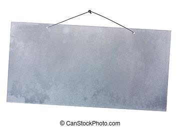 aluminum sheet hanging on a nail