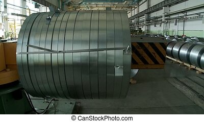 Aluminum sheet uncoils from roll on special machines watch...