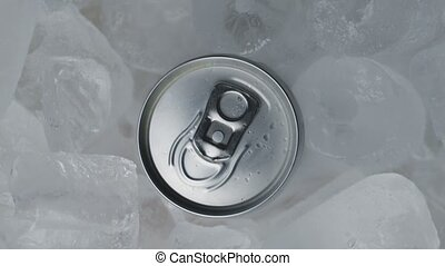 Aluminum Soda Tin Can Rotating in cool Ice motion closeup footage