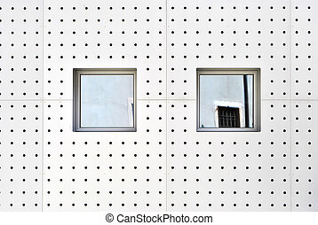 aluminum wall with holes and modern windows