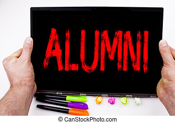 Alumni Former Students text written on tablet, computer in the office with marker, pen, stationery. Business concept for Celebration Education Ending white background with space