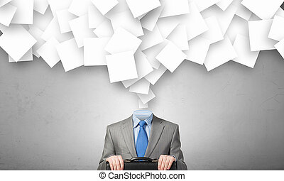 Always busy - Faceless businessman and many papers instead ...