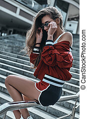 Always confident in her style. Attractive young woman in ...